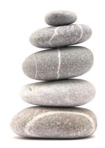 Tame Your Triggers. balancing stone tower isolated on a white background